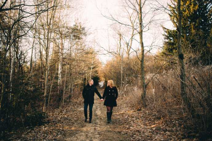 engaged couple walks on trail at long sault conservation area