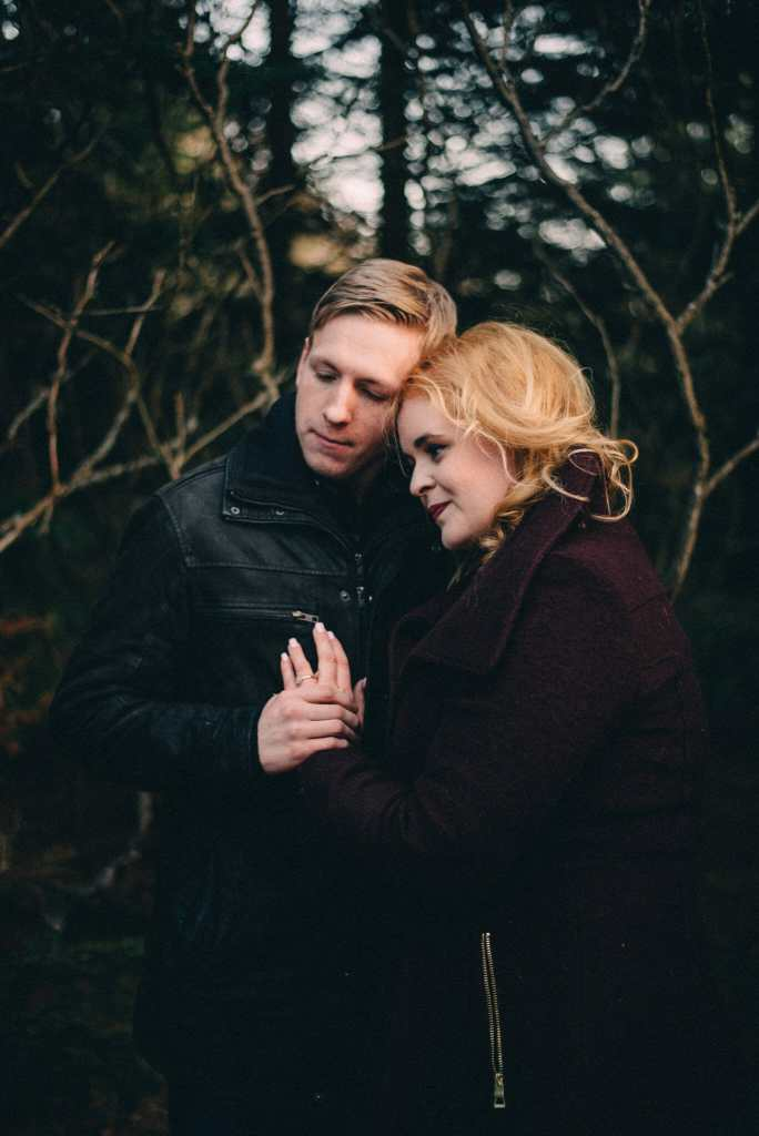 engaged couple in forest