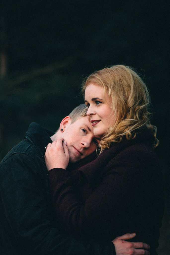 girlfriend holds boyfriend during hike in bowmanville