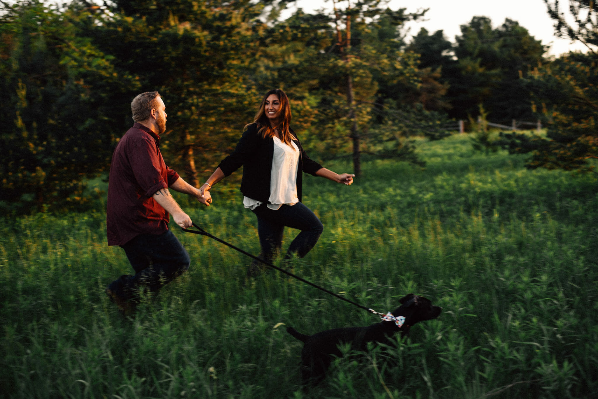couple run with dog and bowmanville engagement photographer