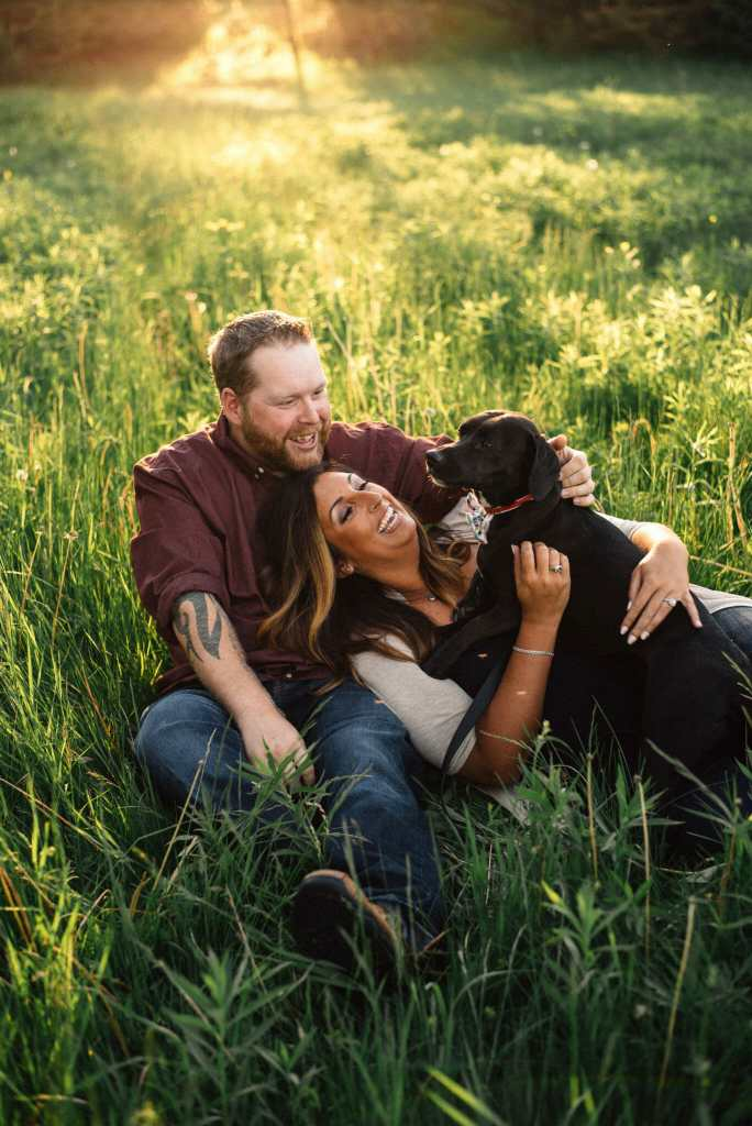 couple cuddling with dog during bowmanville engagement session