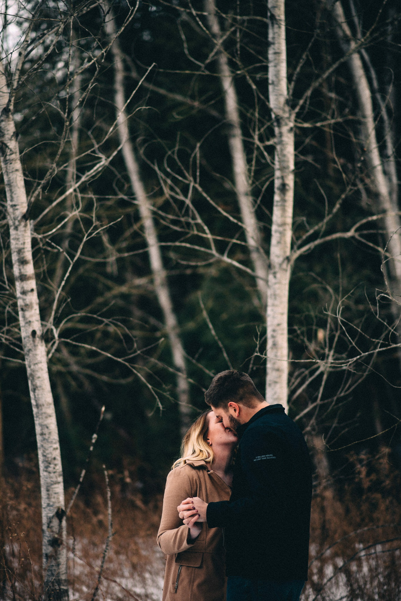 couple kiss during heber down engagement photos