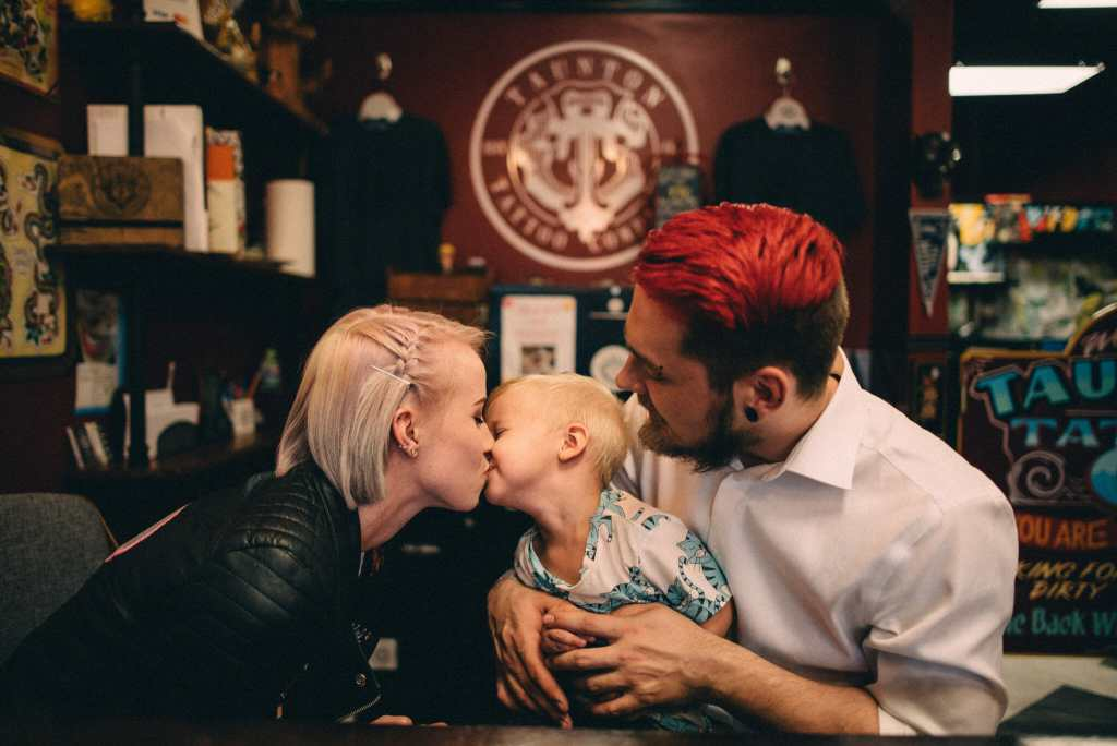 family love during tattoo shop engagement photos