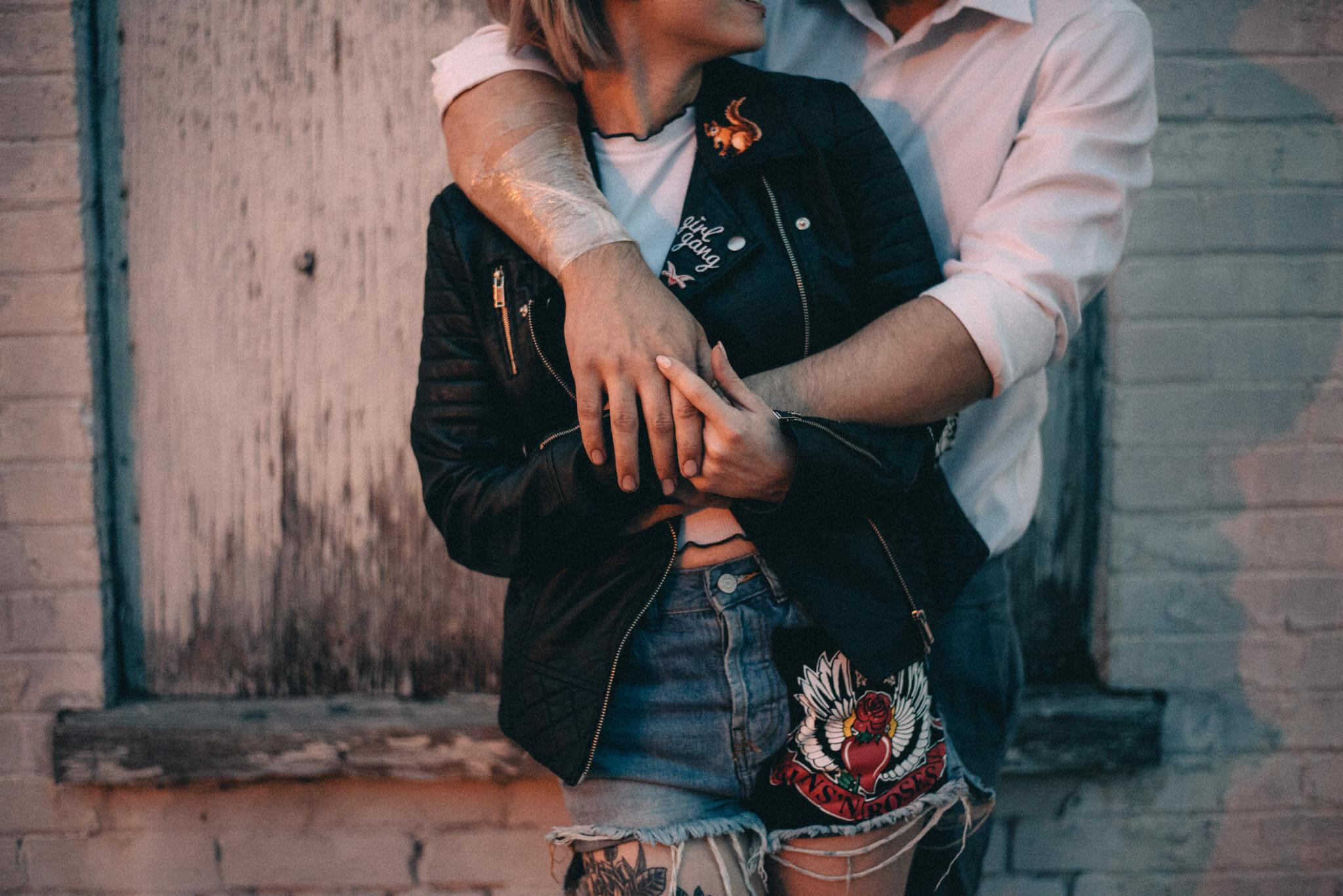 close up of tattooed engaged couple