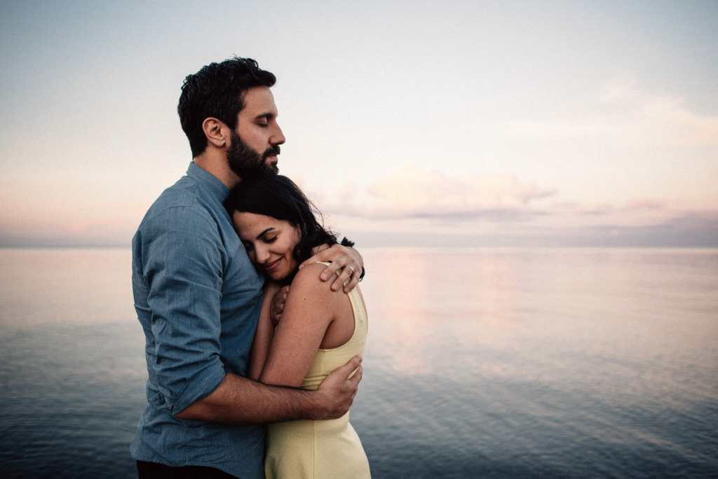 sunset engagement photos on the beach in toronto
