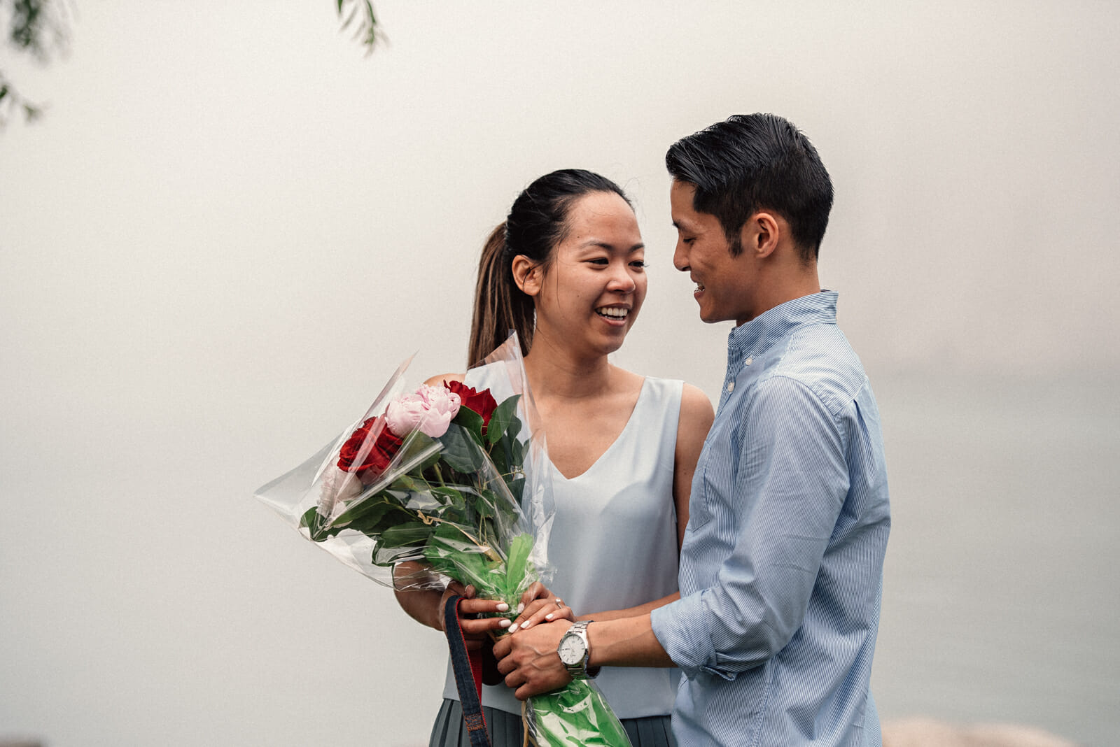 fiance gives fiancee flowers after proposing