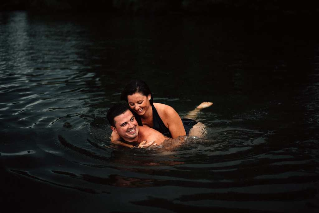 wife piggy backs on husbands back in water