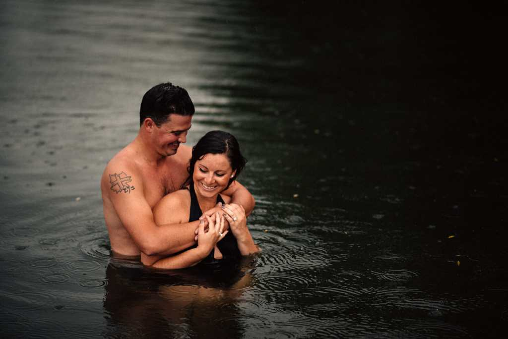 husband hugs wife from behind during sibbald point couple photos lake simcoe