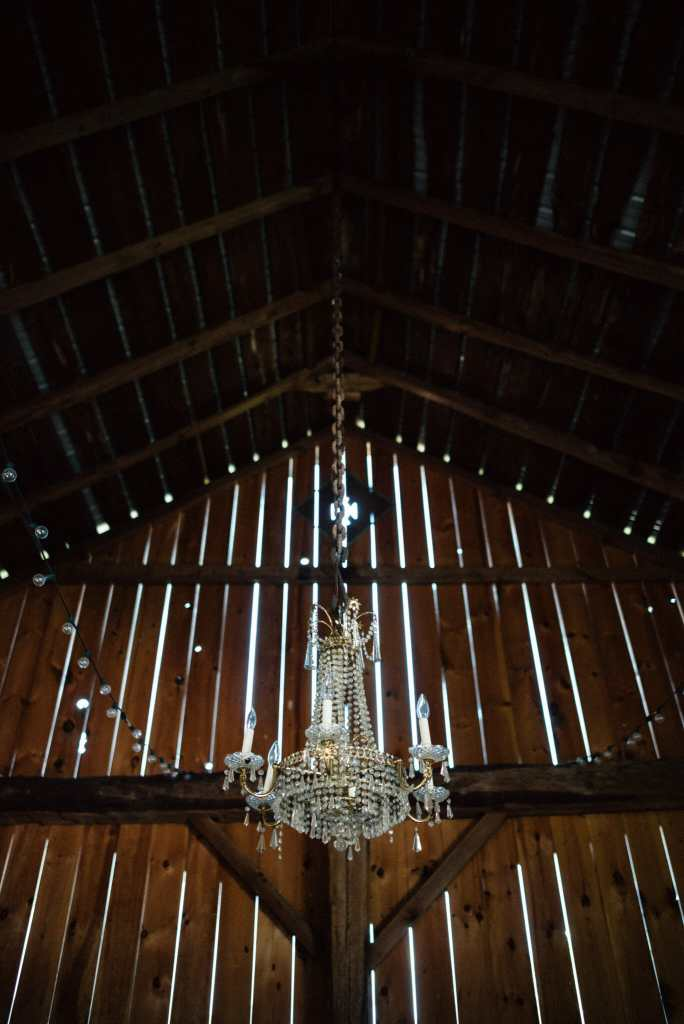 chandelier hanging from barn venue