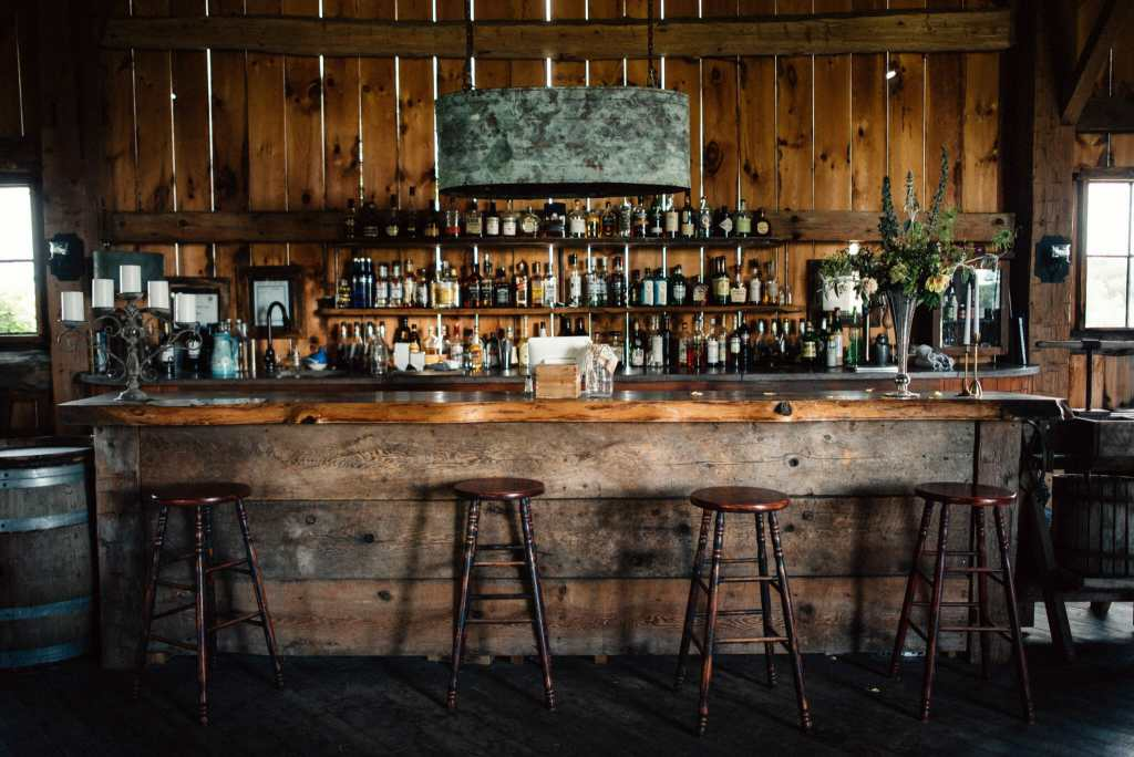 century barn bar with stools and rustic decor
