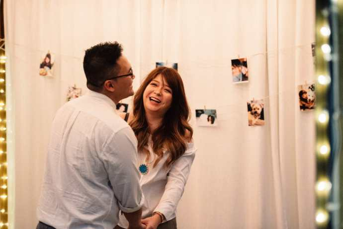 couple laugh and smile after getting engaged