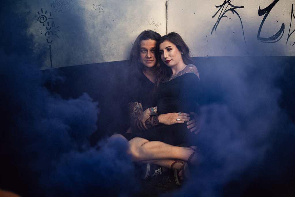 couple embraces during smoke bomb photo shoot