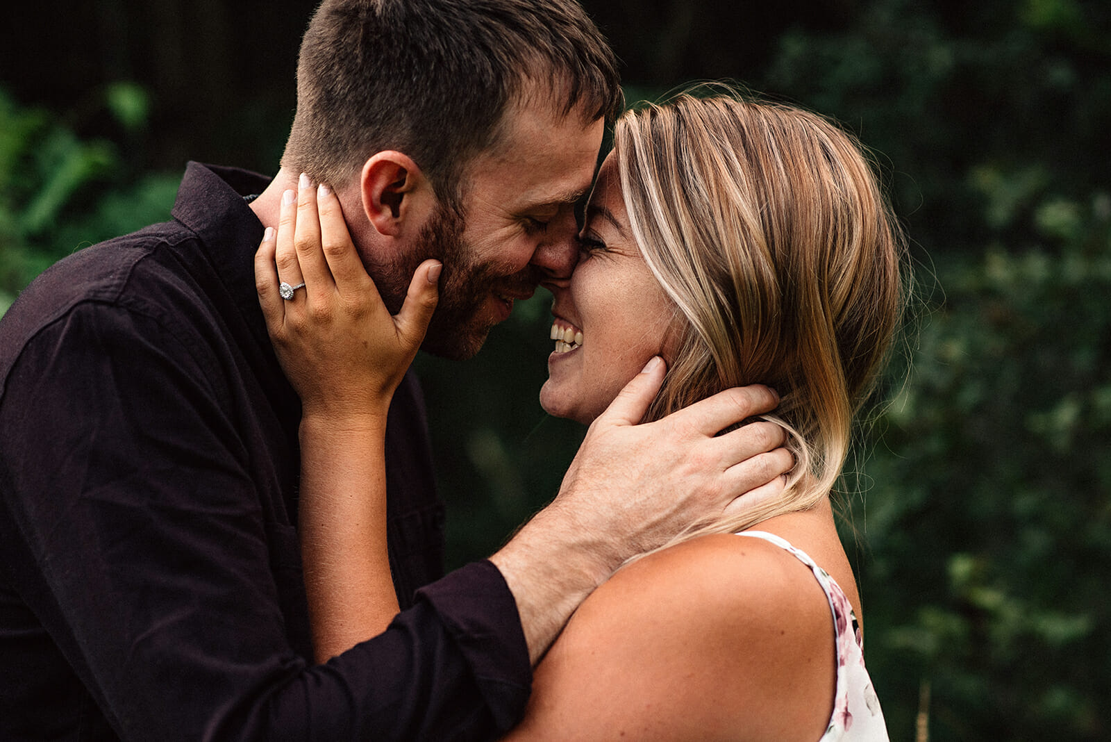 couple laughs during their bowmanville engagement photos session