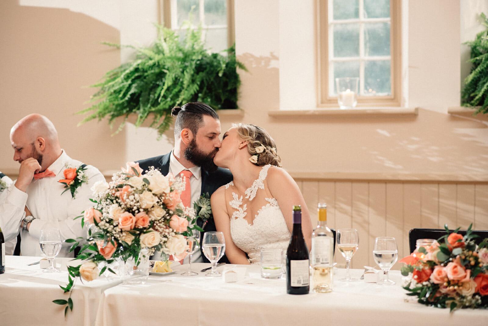 newlyweds kiss during their toronto wedding reception
