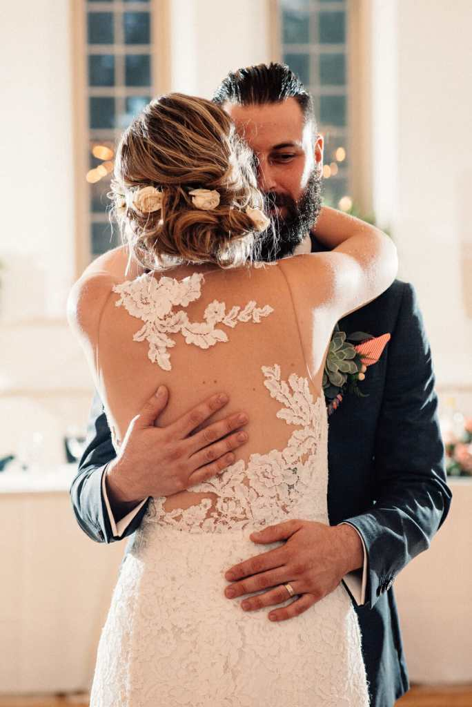 bride and groom share first dance at enoch turner schoolhouse
