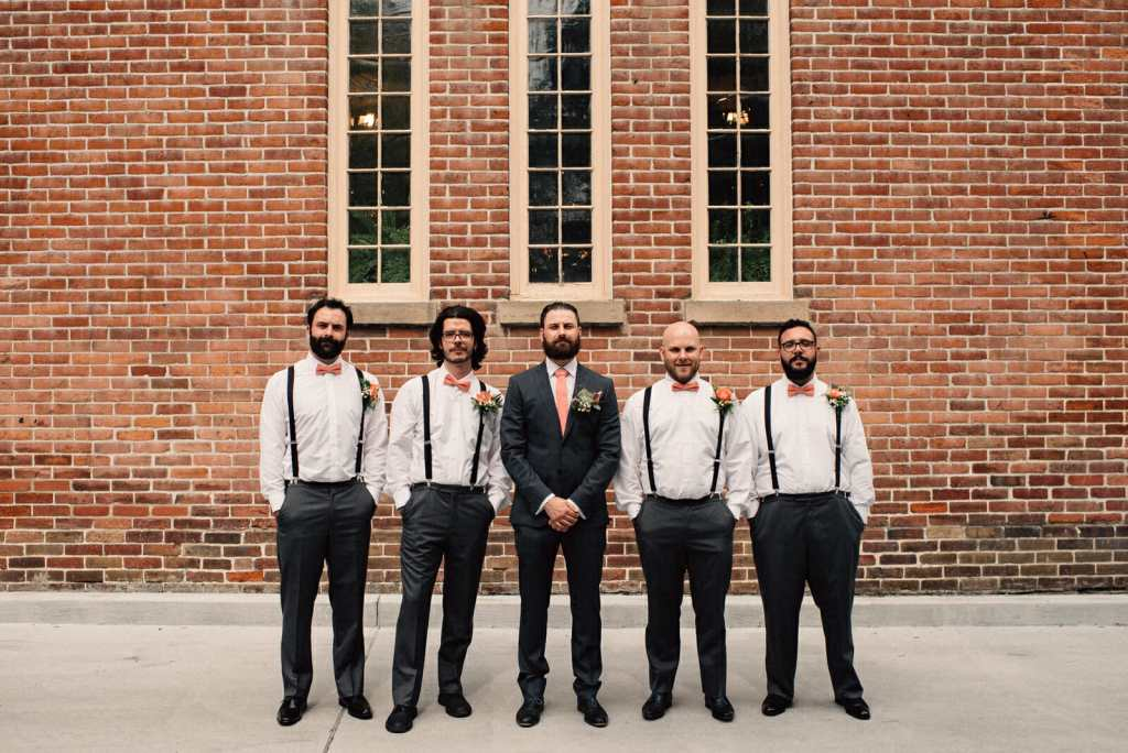 groomsmen photo in front of little trinity church toronto