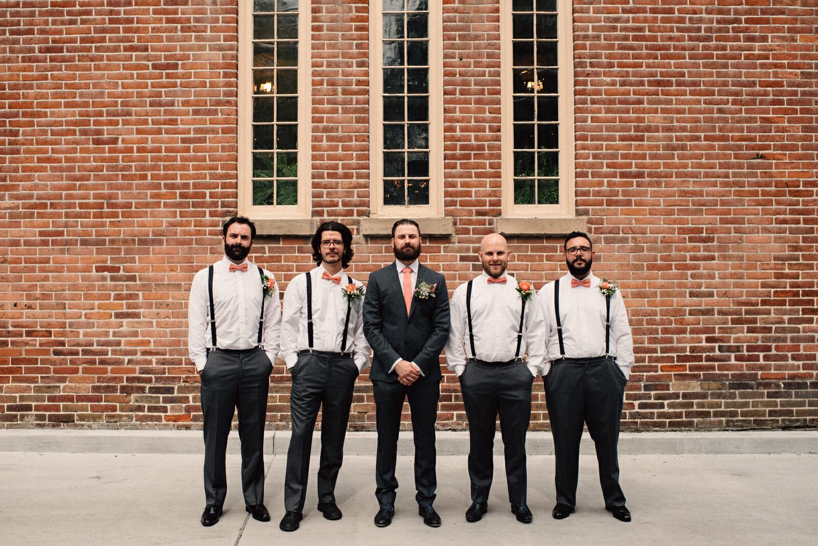 groomsmen photo in front of little trinity church toronto