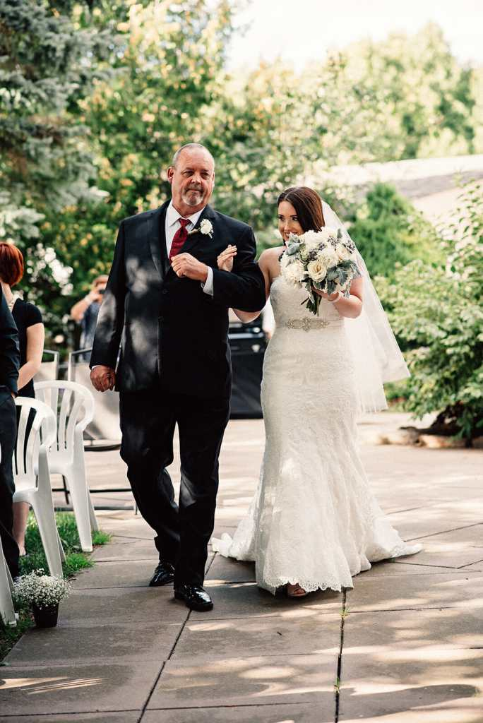 bride and father walk down the aisle at kedron dells