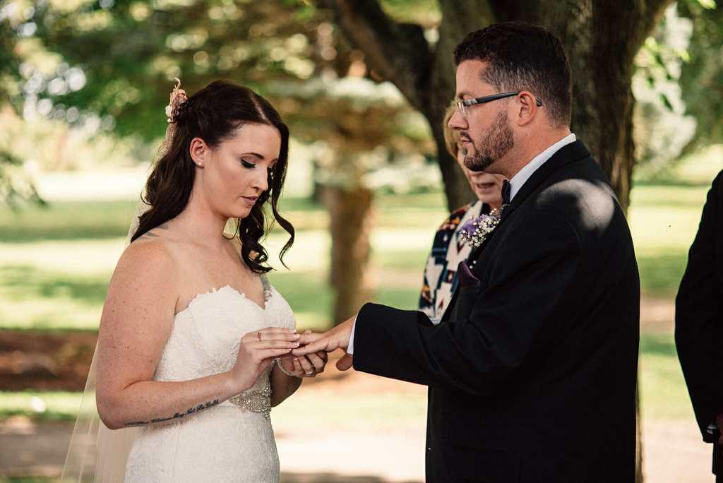 bride and groom exchange wedding rings kedron dells