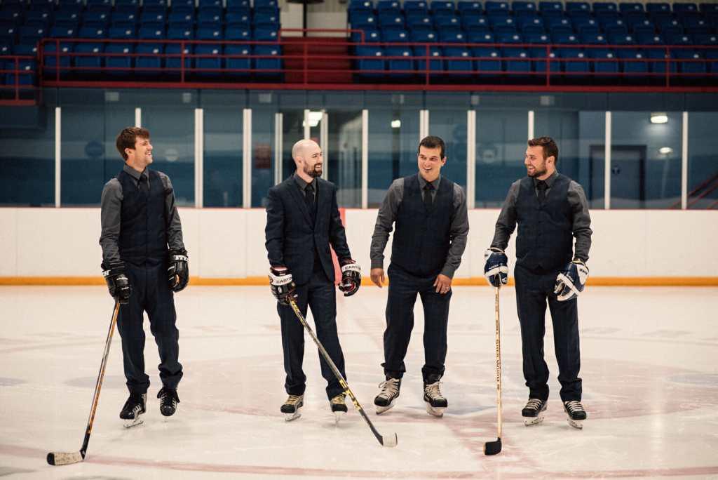 groomsmen laugh while skating on ice