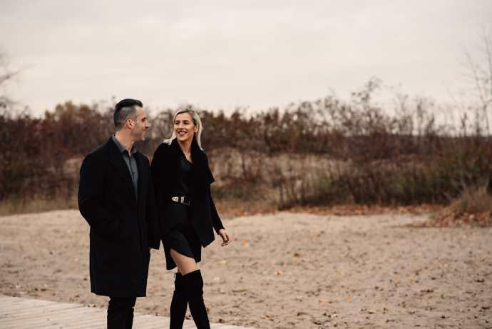 couple walk on the boardwalk at woodbine beach