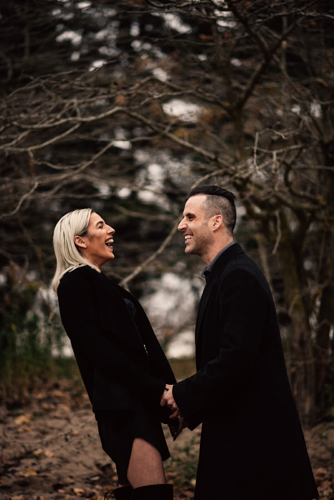 engaged couple shares a laugh at woodbine beach