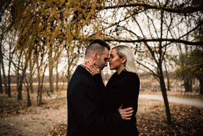 intimate embrace between lovers during fall photos