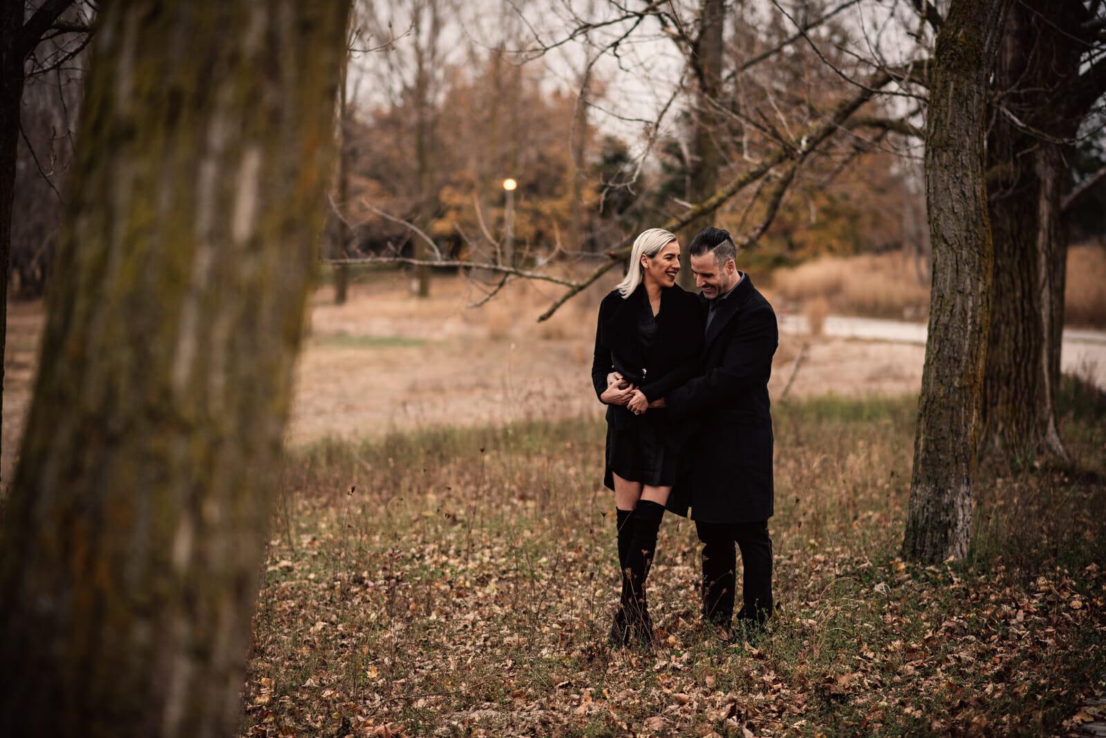 couple laugh during toronto engagement photos