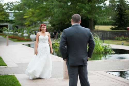 bride and groom have a first look moment before getting married