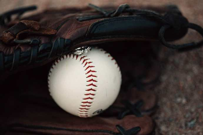 engagement ring on baseball in glove