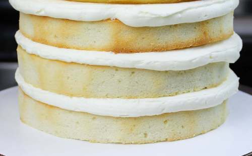 Stacked vanilla cake layers - this recipe is to die for, and can be made in one bowl!!