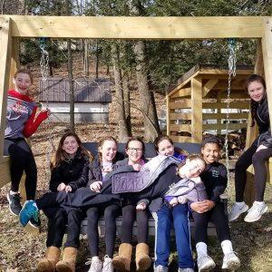 Girls on outdoor swing