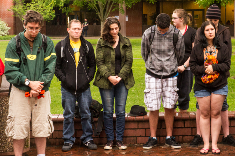 Students observe a moment of silence to honor those who have died in the service of the United States.