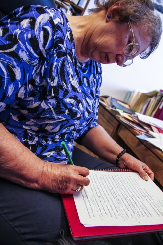 Marjorie Ferry edits one of her last student papers with her famous green pen.