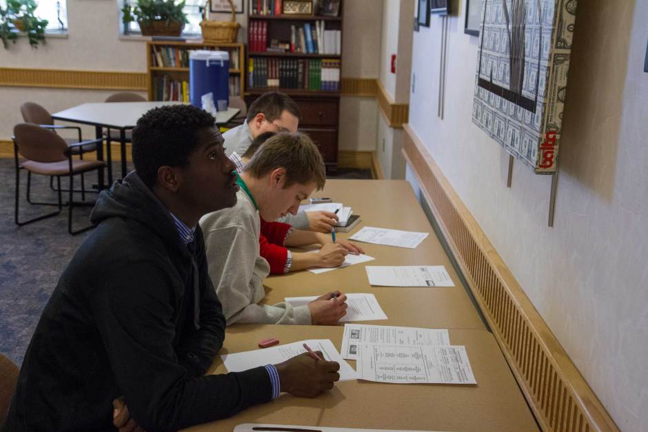 Kekeli Gbofu (front), a first-year computer science student, and Jacob Nix, a first-year general studies student, work on a homework project together in the Multicultural Center in Bldg. 2.