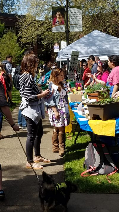 Students interact with a booth at the Earth Day fair. Photo by Svetlana Goloviznina.