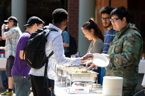 Members of the Associated Students of Chemeketa prepare food for the students. Photo by Caleb Wolf.