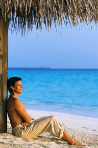 Man Relaxing on Sandy Beach