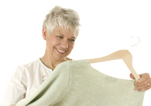 Woman Looking at Cardigan