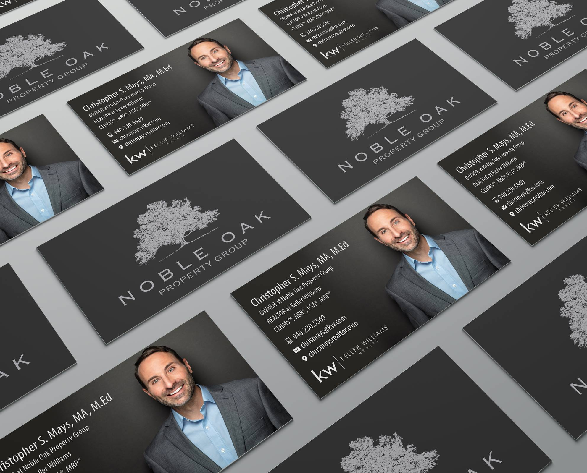 Chris Mays Realtor in a Blue Suit on his business card