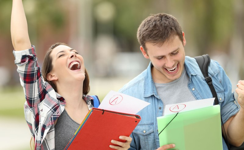 Two students happy after receiving top grades