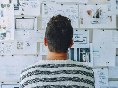 Student staring at board trying to find inspiration for project