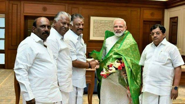 OPS meets Modi, seeks funds for TN