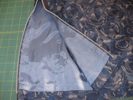 Exposed zipper and lining detail.