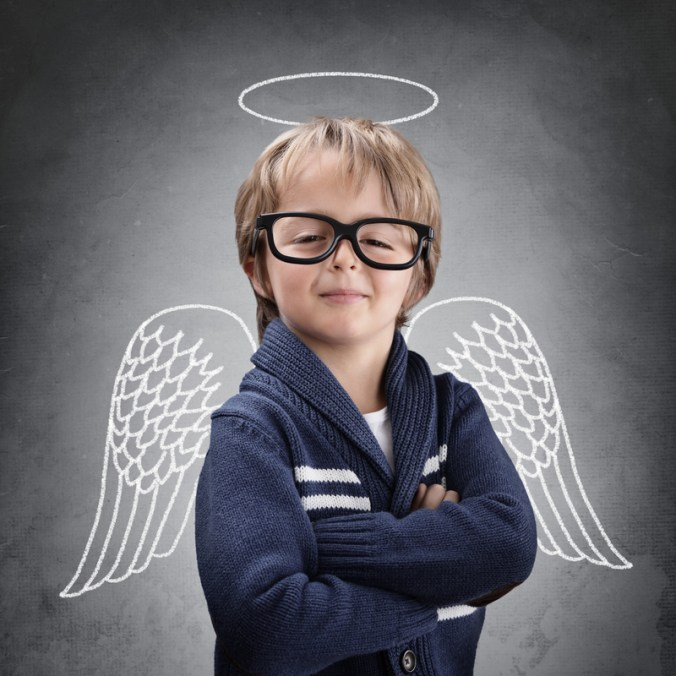 School boy angel with wings and halo