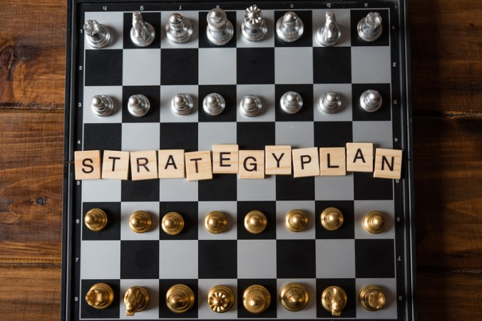 """Chess board and text """"Strategic plan"""" Business planning concept"""