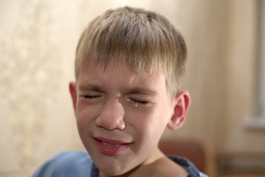 bullied victim crying tears