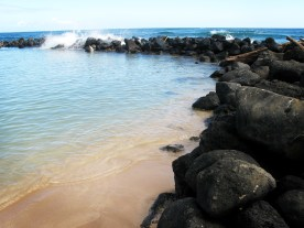 The sheltered bay at Lydgate Park Beach in Kapaa, Kauai.