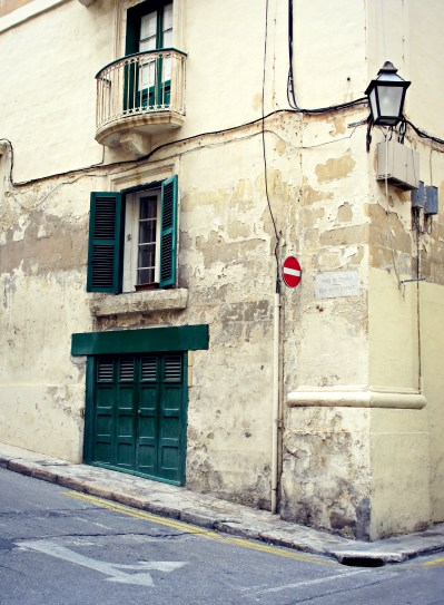 A worn facade with green accents