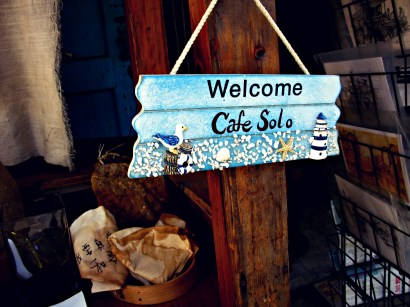 Sign for Cafe Solo, a small cafe along the water in Tai O fishing village.